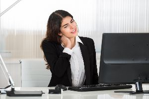 Woman with neck pain from sitting at the computer